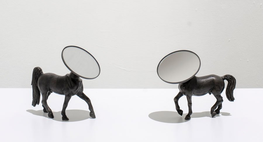 """""""Being borne in a stable does not make you a horse"""", bronce y espejos ajustables, 2008."""